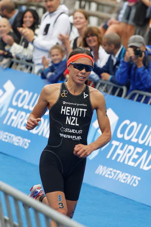 triathlete: STOCKHOLM - JUL 02, 2016: Triathlete Andrea Hewitt (NZL) running at the finish in the Womens ITU World Triathlon series event July 02, 2016 in Stockholm, Sweden