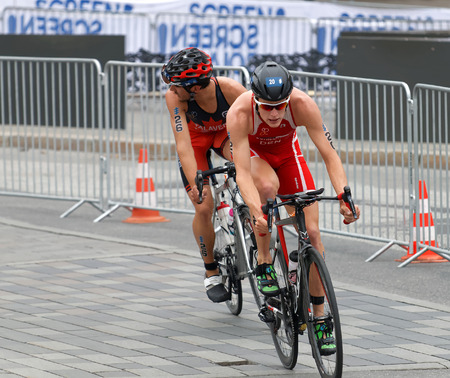 STOCKHOLM, SWEDEN - JUL 02, 2016: Male triathlete cyclists Andreas Schilling and Xavier Grenier-Talavera in the Mens ITU World Triathlon series event July 02, 2016 in Stockholm, Sweden