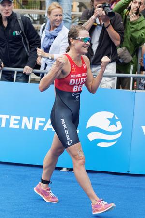 ber: STOCKHOLM - JUL 02, 2016: Winning triathlete Flora Duffy (BER) running at the finish in the Womens ITU World Triathlon series event July 02, 2016 in Stockholm, Sweden Editorial
