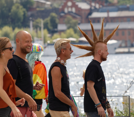 funny hair: STOCKHOLM, SWEDEN - JUL 30, 2016: Group of med with funny hair cut in the Pride parade July 30, 2016 in Stockholm, Sweden Editorial