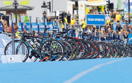 STOCKHOLM - JUL 02, 2016: Lots of triathlete bicycles waiting in the transition zone in the Mens ITU World Triathlon series event July 02, 2016 in Stockholm, Sweden