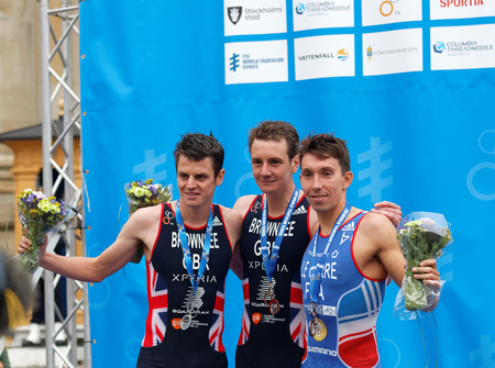 medalist: STOCKHOLM - JUL 02, 2016: The smiling triathlete medalist Alistair and Jonathan Brownlee and Pierre Le Corre on the podium in the Mens ITU World Triathlon series event July 02, 2016 in Stockholm, Sweden