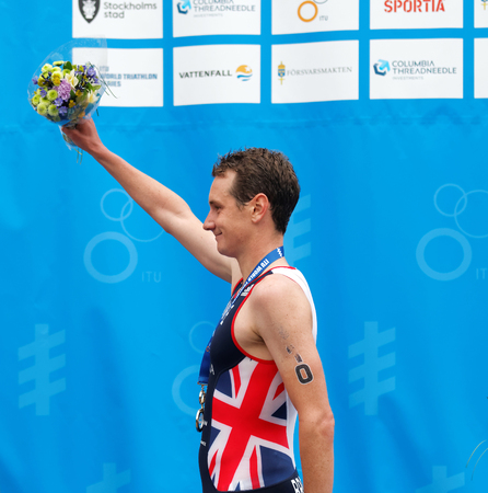 STOCKHOLM - JUL 02, 2016: The gold medalist triathletes Alistair Brownlee holding flowers on the podium in the Mens ITU World Triathlon series event July 02, 2016 in Stockholm, Sweden Editorial