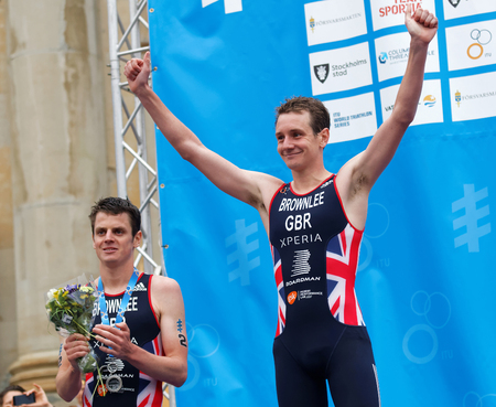 medalist: STOCKHOLM - JUL 02, 2016: The smiling triathlete medalist Alistair and Jonathan Brownlee on the podium in the Mens ITU World Triathlon series event July 02, 2016 in Stockholm, Sweden