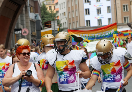 transsexual: STOCKHOLM, SWEDEN - JUL 30, 2016: Group of american football players with helmets in the Pride parade July 30, 2016 in Stockholm, Sweden Editorial