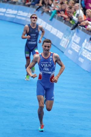 STOCKHOLM - JUL 02, 2016: Running triathlete Simon Vain at the finish in the Mens ITU World Triathlon series event July 02, 2016 in Stockholm, Sweden