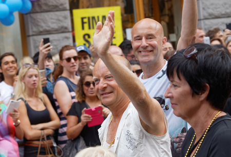 comedian: STOCKHOLM, SWEDEN - JUL 30, 2016: The swedish writer and comedian Jonas Gardell, his man Mark Levengood and the politician Mona Sahlin in the Pride parade July 30, 2016 in Stockholm, Sweden