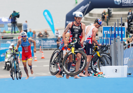 STOCKHOLM - JUL 02, 2016: Triathlete Alistair Brownlee and Fernando Alarza in the transition zone in the Mens ITU World Triathlon series event July 02, 2016 in Stockholm, Sweden