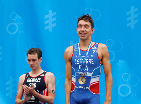 medalist: STOCKHOLM - JUL 02, 2016: The smiling triathlete medalist Alistair and Pierre Le Corre on the podium in the Mens ITU World Triathlon series event July 02, 2016 in Stockholm, Sweden