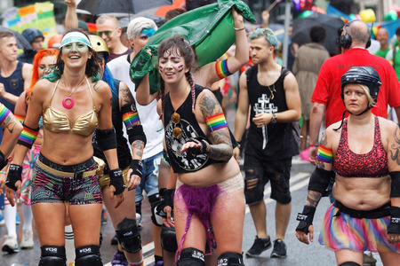 bisexual women: STOCKHOLM, SWEDEN - JUL 30, 2016: Group of roller skating happy girls in spectacular clothes in the Pride parade July 30, 2016 in Stockholm, Sweden Editorial