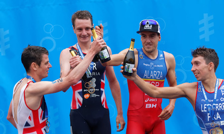 medalist: STOCKHOLM - JUL 02, 2016: The medalist triathletes Alistair and Jonathan Brownlee, Pierre Le Corre and Fernando Alarza drinking champagne on the podium in the Mens ITU World Triathlon series event July 02, 2016 in Stockholm, Sweden