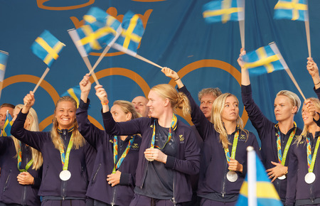 female soccer: STOCKHOLM, SWEDEN - AUG 21, 2016: Happy swedish female soccer team waving swedish flags when the swedish olympic athletes are celebrated in Kungstradgarden, Stockholm,Sweden,August 21,2016 Editorial