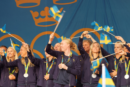 STOCKHOLM, SWEDEN - AUG 21, 2016: Happy swedish female soccer team waving swedish flags when the swedish olympic athletes are celebrated in Kungstradgarden, Stockholm,Sweden,August 21,2016 Editorial