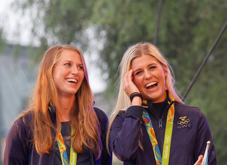 STOCKHOLM, SWEDEN - AUG 21, 2016: Happy swedish female soccer team when the swedish olympic athletes are celebrated in Kungstradgarden, Stockholm,Sweden,August 21,2016