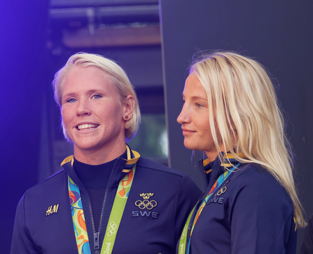 grapple: STOCKHOLM, SWEDEN - AUG 21, 2016: Happy swedish female wrestler Jenny Fransson and Sofia Mattson when swedish olympic athletes are celebrated in Kungstradgarden, Stockholm,Sweden,August 21,2016
