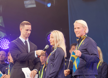 grapple: STOCKHOLM, SWEDEN - AUG 21, 2016: Swedish female wrestler Jenny Fransson and Sofia Mattson getting interviewed when swedish olympic athletes are celebrated in Kungstradgarden, Stockholm,Sweden,August 21,2016