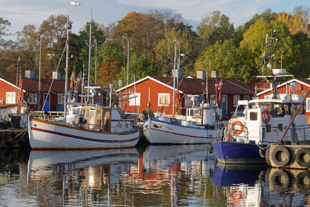 windless: Small fishing boats in the harbor reflecting in the water a perfect sunny, windless morning