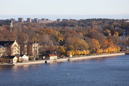 The beautiful Skeppsholmen in central Stockholm during the autumn. Sea, houses and trees Stock Photo