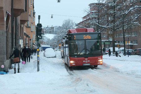 busses: STOCKHOLM, SWEDEN - NOV 10, 2016: Snow chaos in the traffic in central Stockholm. Cars, busses and people. November 10, 2016 in Stockholm, Sweden Editorial