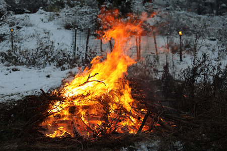 quite: Campfire during dusk, quite high orange flames