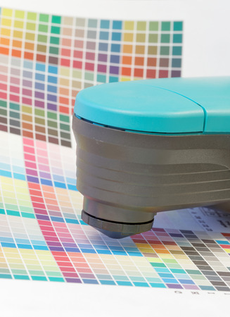 mottle: Spectrometer used for proofing on a leaf of the multi color test print in a pre-press workshop Stock Photo