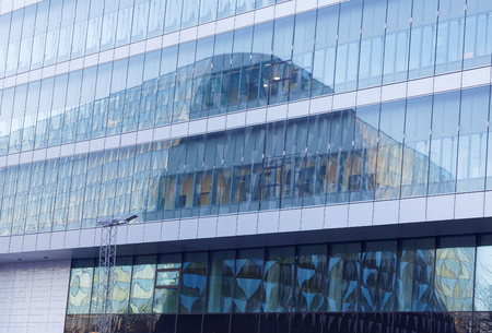 fasade: The conference building Aula Medica reflecting in a glass fasade Stock Photo