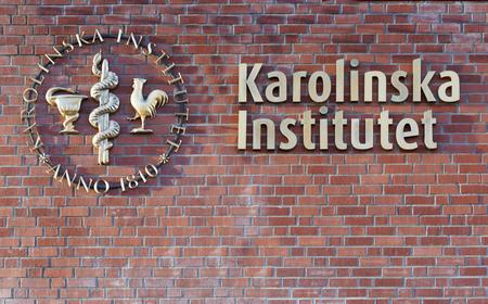 STOCKHOLM - JAN 15, 2017: hospital Karolinska institutet on a brick wall. January 15, 2017 in Stockholm, Sweden
