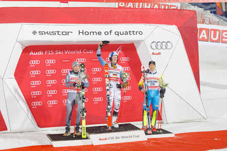 parallel world: STOCKHOLM, SWEDEN - JAN 31, 2017: Winner Linus Strasser (GER) and Mikaela Shiffrin (USA) on the podium at the FIS Alpine Ski World Cup - city event January 31, 2017, Stockholm, Sweden