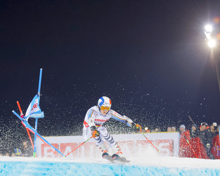 STOCKHOLM, SWEDEN - JAN 31, 2017: Snow squirting from Linus Strasser (GER) in the parallel slalom downhill alpine skiing event Audi FIS Ski World Cup. January 31, 2017, Stockholm, Sweden