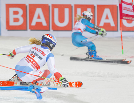 parallel world: STOCKHOLM, SWEDEN - JAN 31, 2017: Side view of Melanie Meillard (SUI) and competiotor in the downhill skiing in the parallel slalom alpine event, Audi FIS Ski World Cup. January 31, 2017, Stockholm, Sweden