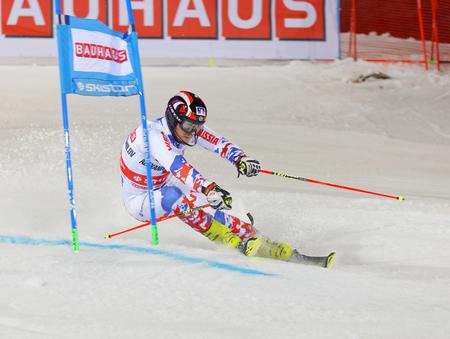 aleksander: STOCKHOLM, SWEDEN - JAN 31, 2017: Aleksander Khorosholv (RUS) fighting in the parallel slalom alpine ski event, Audi FIS Ski World Cup. January 31, 2017, Stockholm, Sweden