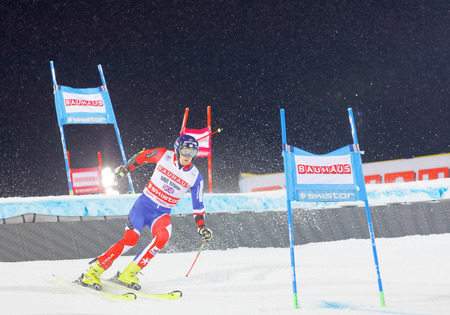 STOCKHOLM, SWEDEN - JAN 31, 2017: Dave Ryding (GBR) downhill skiing when its snowing in the parallel slalom alpine event, Audi FIS Ski World Cup. January 31, 2017, Stockholm, Sweden Editorial