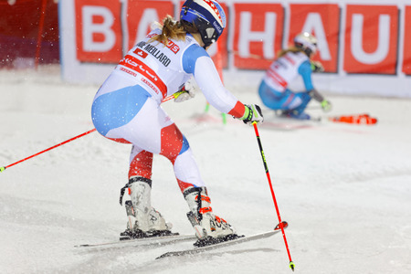 STOCKHOLM, SWEDEN - JAN 31, 2017: Side view of Melanie Meillard (SUI) and competiotor in the downhill skiing in the parallel slalom alpine event, Audi FIS Ski World Cup. January 31, 2017, Stockholm, Sweden