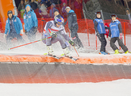 parallel world: STOCKHOLM, SWEDEN - JAN 31, 2017: Manfred Moeigg (ITA) jumping in the downhill skiing in the parallel slalom alpine event, Audi FIS Ski World Cup. January 31, 2017, Stockholm, Sweden