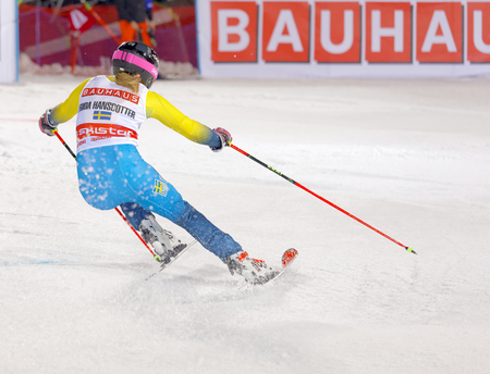 parallel world: STOCKHOLM, SWEDEN - JAN 31, 2017: Rear view of Frida Hansdotter (SWE) in the parallel slalom downhill skiing, at the Alpine Audi FIS Ski World Cup - city event January 31, 2017, Stockholm, Sweden