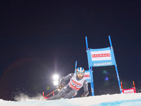 STOCKHOLM, SWEDEN - JAN 31, 2017: Manfred Moeigg (ITA) squirting snow in the downhill skiing in the parallel slalom alpine event, Audi FIS Ski World Cup. January 31, 2017, Stockholm, Sweden