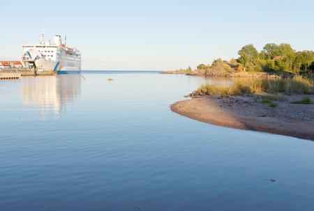 GRISSLEHAMN, SWEDEN - JUL 12, 2016: PPassenger ferry in the harbor and blue, calm water sea in the swedish archipelago. July 12, 2016, Grisslehamn, Sweden