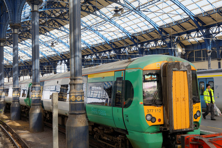 brighton: BRIGHTON, GREAT BRITAIN - FEB 24, 2017: Two trains in the beautiful old train station in Brighton, UK. February 24, 2017 in Brighton, Great Britain