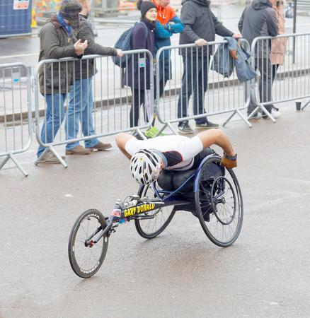 BRIGHTON, GREAT BRITAIN - FEB 26, 2017: Man i sports wheelchair fighting in the Vitality Brighton half marathon competition. February 26, 2017 in Brighton, Great Britain Editöryel