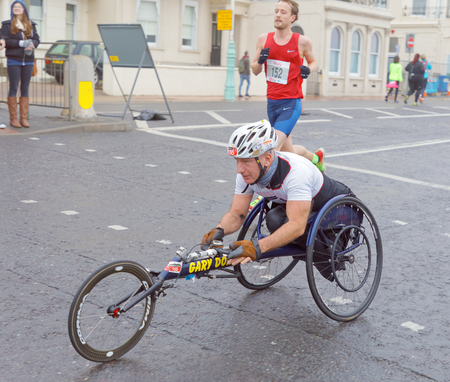 BRIGHTON, GREAT BRITAIN - FEB 26, 2017: Man i sports wheelchair in the Vitality Brighton half marathon competition. February 26, 2017 in Brighton, Great Britain