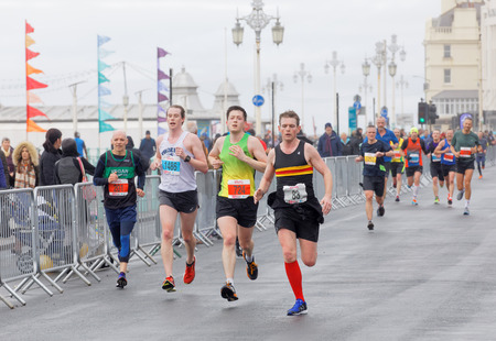 brighton: BRIGHTON, GREAT BRITAIN - FEB 26, 2017: Group of runners close to the finish line in the Vitality Brighton half marathon competition. February 26, 2017 in Brighton, Great Britain