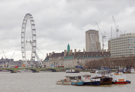 LONDON, GREAT BRITAIN - FEB 27, 2017: London Eye and the river Thames a cloudy day. February 27, 2017 in London, Great Britain