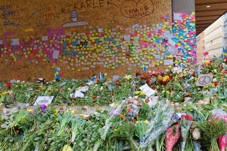 hijack: STOCKHOLM, SWEDEN - APR 12, 2017: Lots of flowers and messages on post-it notes in central Stockholm where the lorry crashed from people paying respect to the victims in the terror attack in Stockholm April 07, 2017. April 13, 2017 in Stockholm, Sweden