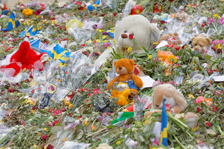 hijack: STOCKHOLM, SWEDEN - APR 17, 2017: Flowers Teddy bears from people paying respect to the victims in the terror attack in Stockholm April 07, 2017. April 17, 2017 in Stockholm, Sweden Editorial