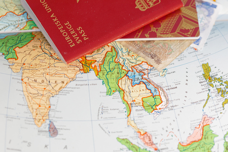 Passport and on a map of Asia including India, Thailand, Vietnam and Burma