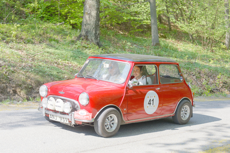 cooper: STOCKHOLM, SWEDEN - MAY 22, 2017: Red Mini Cooper S classic car from 1965 driving on a country road in the public race Gardesloppet in the forests at Djurgarden, Stockholm, Sweden. May 22, 2017