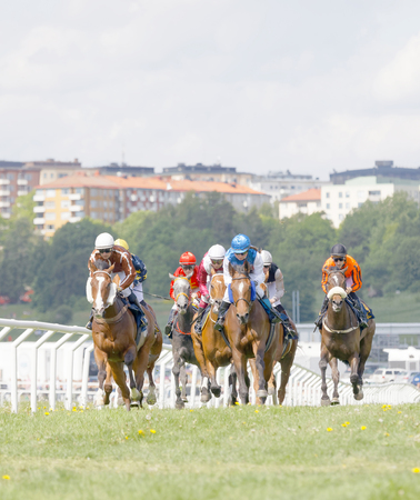 rival: STOCKHOLM, SWEDEN - JUNE 06: Tough race between the race horses and colorful jockeys at Nationaldags Galoppen at Gardet. June 6, 2017 in Stockholm, Sweden Editorial