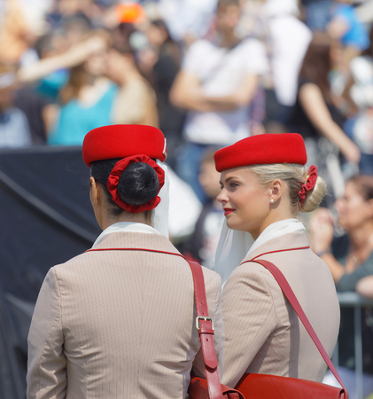 personel: STOCKHOLM, SWEDEN - JUNE 06, 2017: Two beautiful female cabin crew personel from Emirates at Nationaldags Galoppen at Gardet. June 6, 2017 in Stockholm, Sweden Editorial