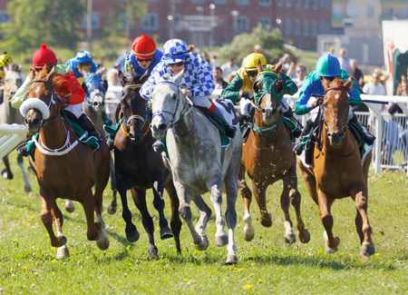rival: STOCKHOLM, SWEDEN - JUNE 06, 2017: Jockeys on gallop arabian race horses storming ahead at Nationaldags Galoppen at Gardet. June 6, 2017 in Stockholm, Sweden Editorial