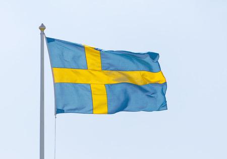Swedish flag and light blue summer sky